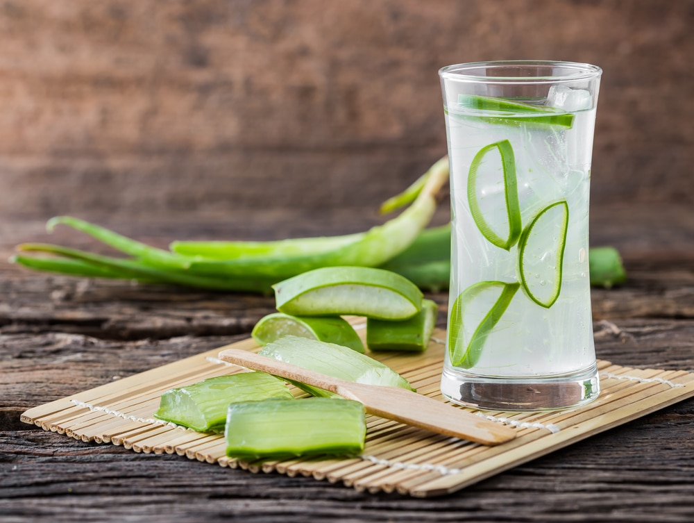 Aloe vera juice in a glass which helps in soothing the stomach pain